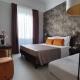 I5083_20210318110346_junior_suites_firenze_centro_hotel_0005_toscana_verde_camere_a_poco_prezzo_cippia.jpg